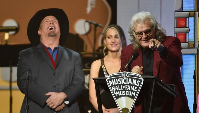 Ricky Scaggs, 2016 Musicians Hall of Fame inductee, addresses the crowd as presenter Garth Brooks laughs on Wednesday, Oct. 26, 2016, in Nashville Tenn.