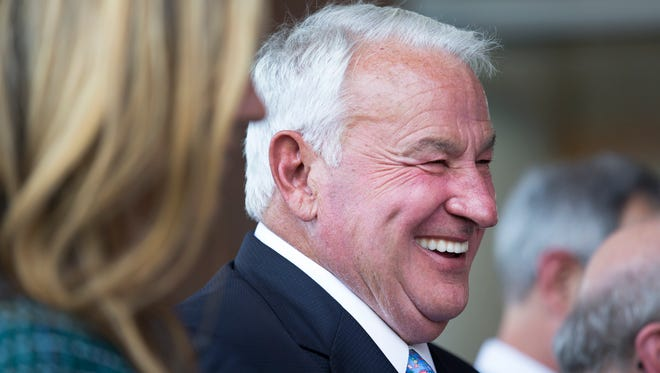 Tom Golisano laughs last year during a ribbon cutting ceremony at the new Golisano Children's Hospital.