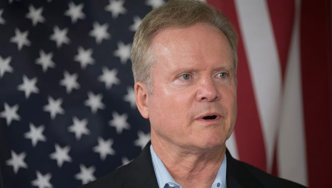 Former Virginia senator Jim Webb listens to speakers at the Urbandale Democrats Flag Day celebration on June 14, 2015, in Urbandale, Iowa.