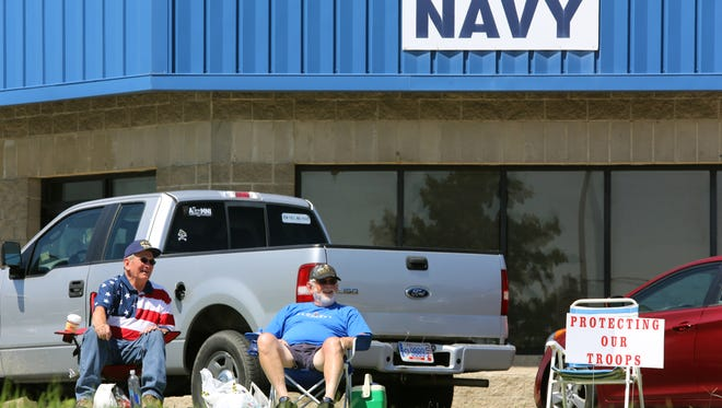 Jerry Peterson of Union, Ky., left, and Dennis Kelley of Walton, Ky., sit July 22, 2015, in front of the Armed Forces Recruiting Center in Florence, Ky.