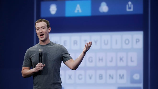 In this March 25, 2015 file photo, Mark Zuckerberg talks about the Messenger app during the Facebook F8 Developer Conference in San Francisco.