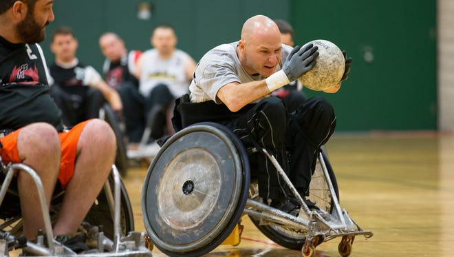 Dave Zacks with the Pittsburgh Steelwheelers catches a pass during a wheelchair rugby tournament hosted by the Western New York Wreckers at the College at SUNY Brockport on Saturday.