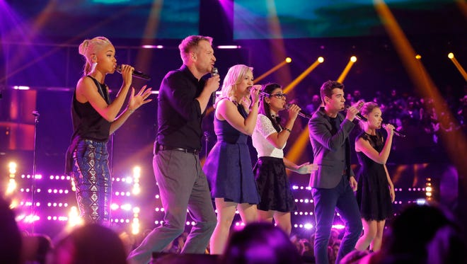 Nadjah Nicole (left) performing on The Voice Wednesday night with fellow contestants Barrett Baber, Morgan Frazier, Ivonne Acero, Zach Seabaugh and Emily Ann Roberts.