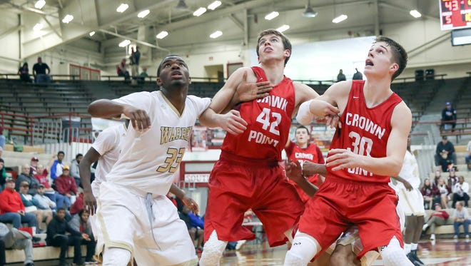 Crown Point's Grant Gelon (right) struggled with just 2 points in Saturday's loss to Warren Central at Southport.