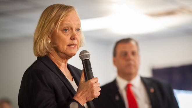 Tech executive Meg Whitman and New Jersey Gov. Chris Christie campaigning earlier this month in Epping, N.H., before he ended his White House bid.