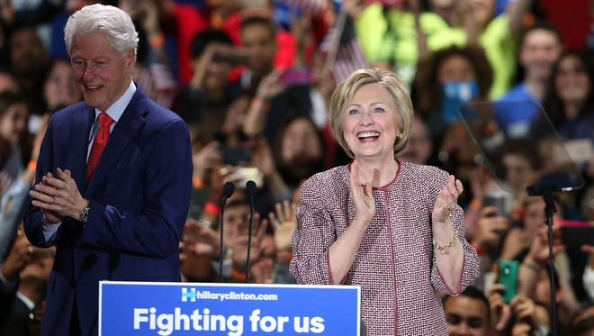 Hillary Clinton walks on stage with her husband, Bill Clinton, after winning the New York primary on April 19, 2016.
