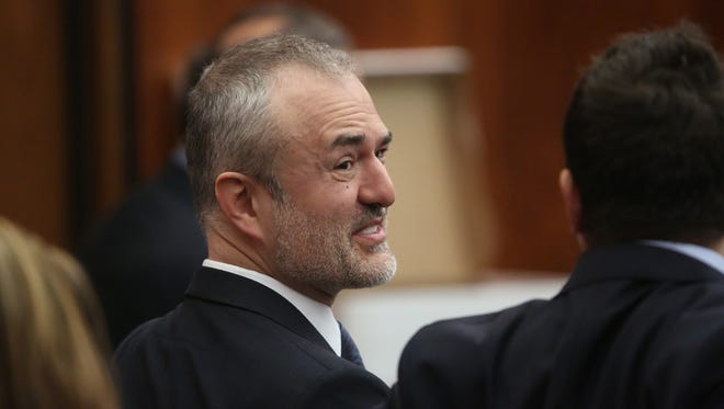 Nick Denton, founder of Gawker, talks with his legal team before Terry Bollea, aka Hulk Hogan, testifies in court during his trial against Gawker Media at the Pinellas County Courthouse on March 8, 2016, in St. Petersburg, Fla. Bollea is taking legal action against Gawker in a $100 million lawsuit for releasing a video of him having sex with his best friend's wife.