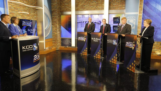 KCCI anchor Steve Karlin, left, and Des Moines Register political columnist Kathie Obradovich moderate the US Senate candidates Tom Fiegen, Rob Hogg, Bob Krause and Patty Judge during the US Senate Democratic primary debate at the KCCI newsroom in Des Moines, Wednesday, June 1, 2016.