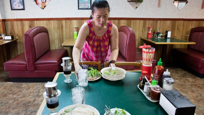 Annie Tran serves a bowl of pho at her restaurant, Annie's Cafe.
