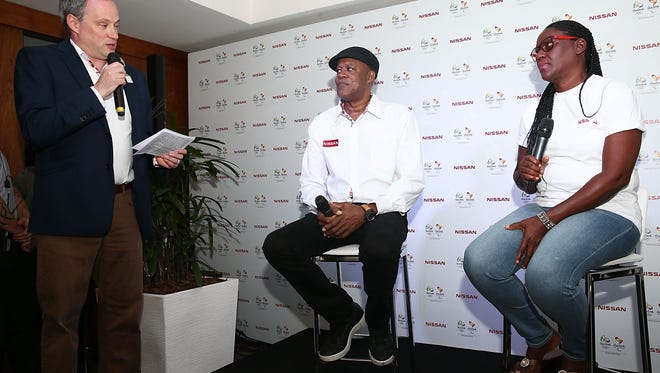 Jonathan Adashek, Vice President Global Communications and Chief Communications Officer of Nissan Motor Corporation, Ltd., moderates a press conference with Wellesley and Jennifer Bolt, Usain Bolt's parents.