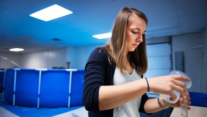 Valeska Minkowski, owner of Urban Seas Aquaculture, tests the pH levels of tanks in her shrimp farm on Monday, December 5, 2016.