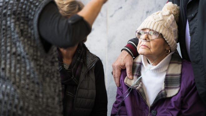 Regina Tague, mother of Todd Kohlhepp, speaks with family members of Superbike Motorsports victims outside of the courtroom before a hearing for a lawsuit filed by Kayla Brown against Kohlhepp at Spartanburg County Courthouse on Thursday, January 5, 2017.