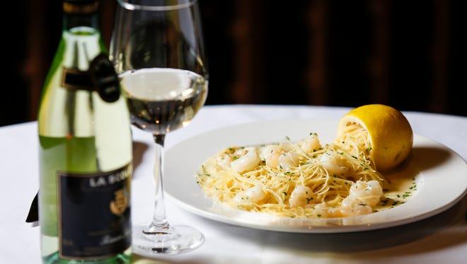 The Capellini di Sorrento dish with a glass of La Scolca Bianco Secco at Volaré Restaurant in Louisville.