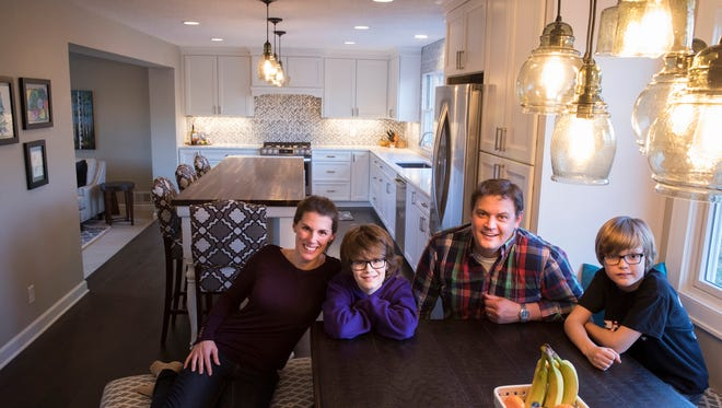 Cassie and Scott Frick and sons, Owen, left, 12, and Cole, 8, enjoy their remodeled and expanded kitchen in Minnetonka, Minn.