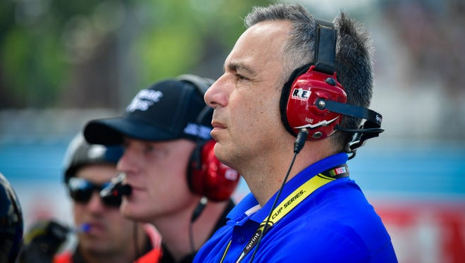 Doug Duchardt (right), general manager of Hendrick Motorsports, will step down at the end of the month.