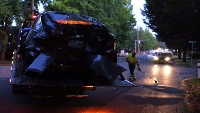A Tesla car sits with a smashed-in rear end after a crash in Salem, Ore., on Saturday, Aug. 5, 2017.