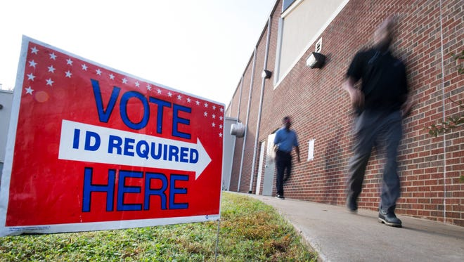 Voters leave the West End Community Development Center on Tuesday, November 7, 2017.