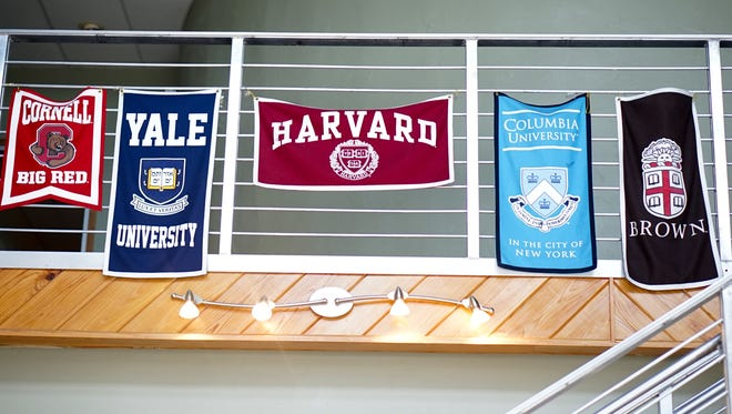 Flags in the entryway of T.M. Landry College Prep show universities that have accepted the school's students.