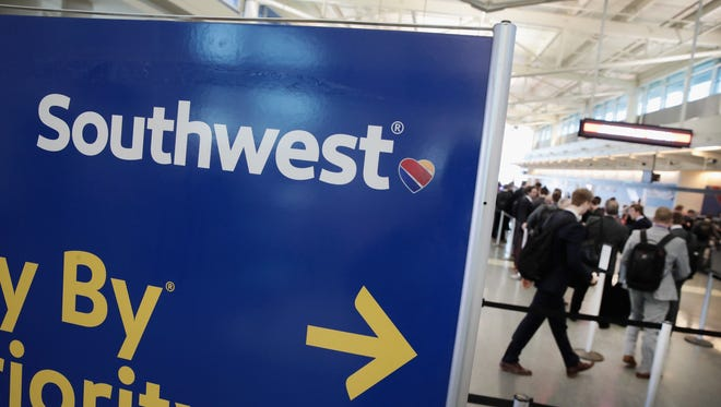 Southwest Airlines passengers check in for flights at Midway Airport on Jan. 25, 2018 in Chicago.