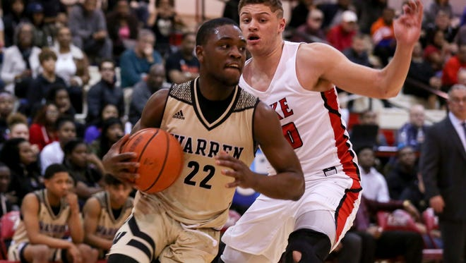Warren Central's David Bell drives by a Pike defender in Tuesday's narrow Warriors win.