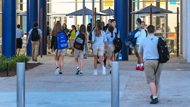 Students arrive at Southside High in Youngsville, LA for the first day of school. Wednesday, Aug. 9, 2017.
