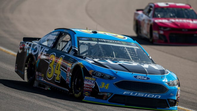 K-Love Radio Ford's Michael McDowell goes around turn three during the Monster Energy NASCAR Cup Series qualifying on Friday, Mar. 9, 2018 at ISM Raceway in Avondale, Ariz.
