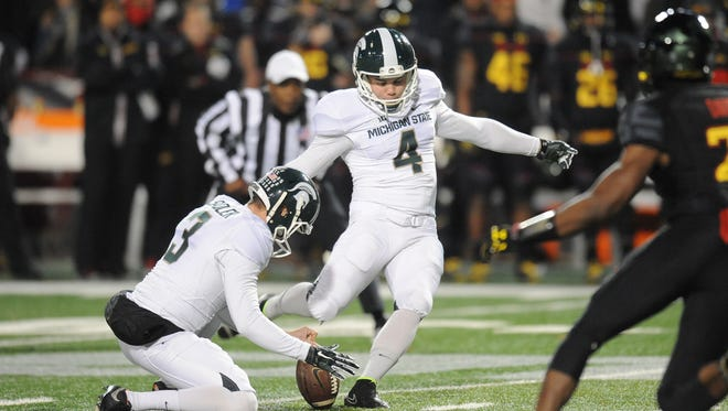 Michael Geiger of the Michigan State Spartans hits his second field goal in the first quarter to make the score 6-0 during a college football game against the Maryland Terrapins at Byrd Stadium on November 15, 2014 in College Park, Maryland.