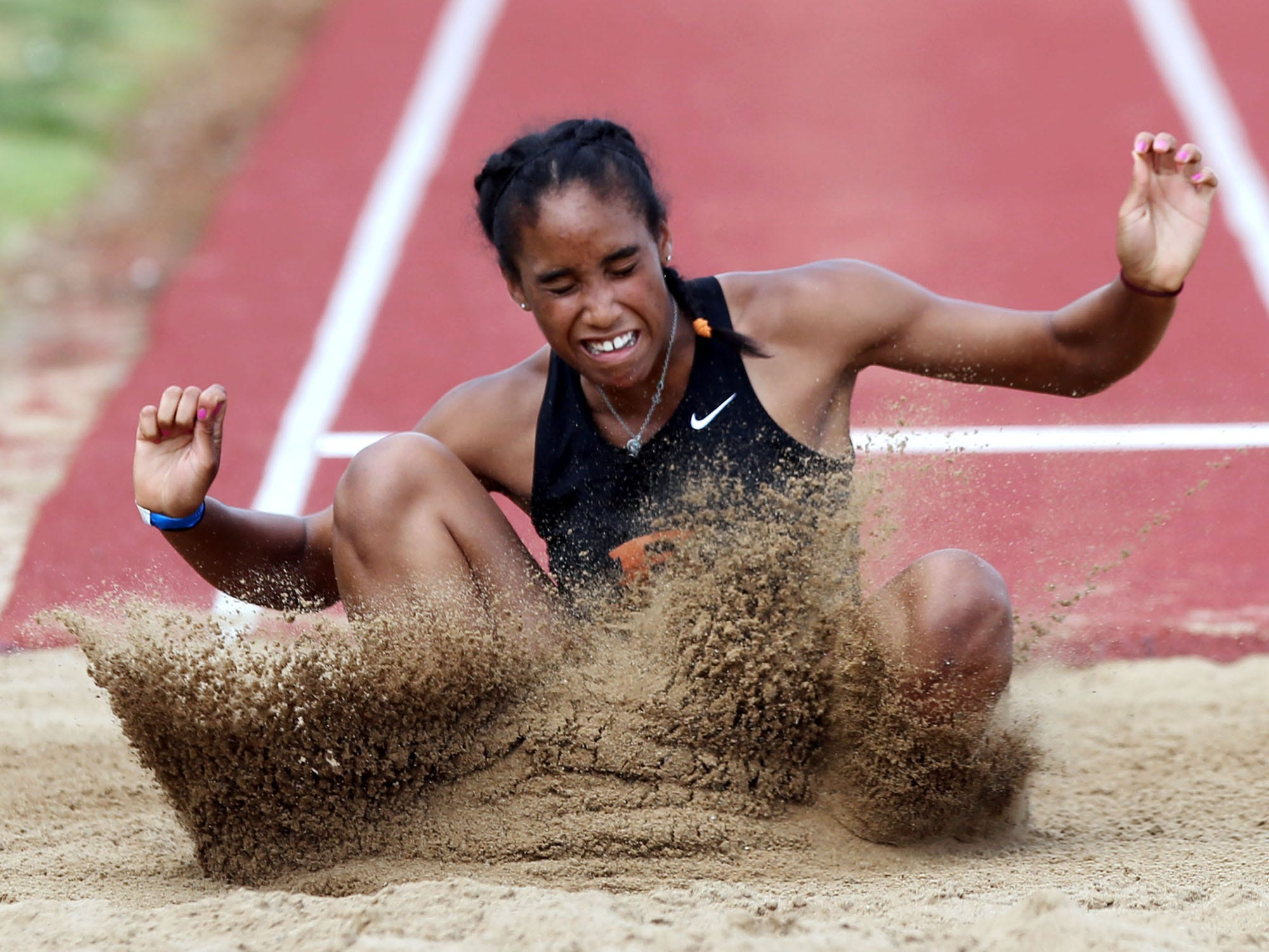 Ensworth's Tyra Gittens competes in the long jump Monday. She won her second straight pentathlon.