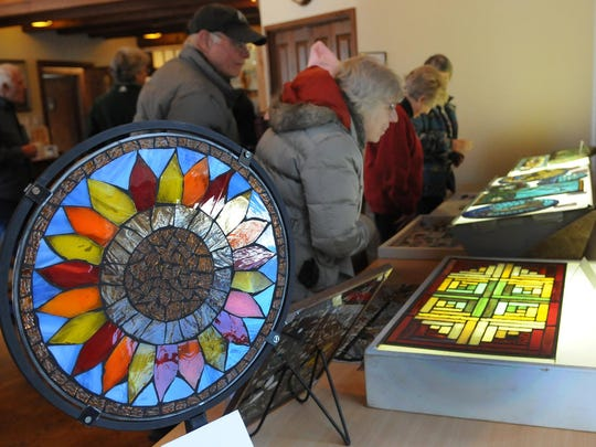 This stained glass mosaic was created by Mia Dewit