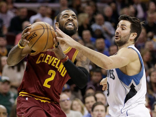 Cleveland Cavaliers' Kyrie Irving (2) drives against Minnesota Timberwolves' Ricky Rubio (9), from Spain, in the first half of an NBA basketball game, Wednesday, Feb. 1, 2017, in Cleveland. (AP Photo/Tony Dejak)