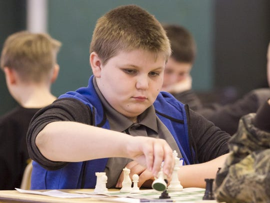 """Roman Turiansky, 12, of Ledgewood captures a pawn. Roman is a contender to win the tourney. The Knights of Columbus host their annual """"Chess 'Round-Robin' Tournament Anyone?"""" for grades 3-8, at Holy Family Roman Catholic Church, Florham Park, NJ. Sat., April 1, 2017. Special to NJ Press Media/Karen Mancinelli/Daily Record MOR 0402 K of C Chess Tournament"""
