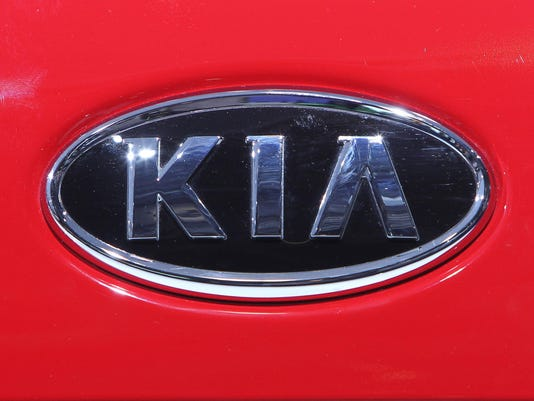The logo of carmaker KIA is seen during