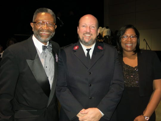 Krewe Sobek Member Reginald Norman, Northwest Louisiana Salvation Army Corps Maj. Ray Morton, Boys & Girls Club Executive Director Paige Smith smile at Sobek Grand Ball. Sobek suppors and volunteers with the club.