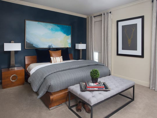 The bedroom has a masculine but comfortable design.