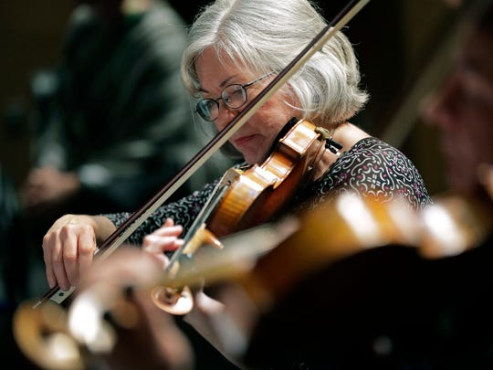 Fox Valley Symphony Orchestra violinist Dorothy Hollenbach performs as part of a string quartet during the In Harmony music program Tuesday, Feb. 28, 2017, at James Madison Middle School in Appleton.