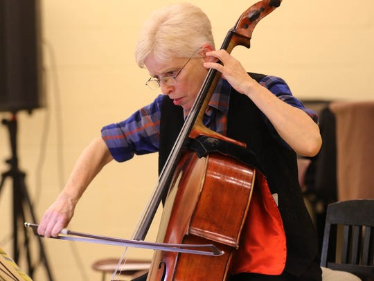 Cellist, E. Zoe Hassman playing one of her many selections