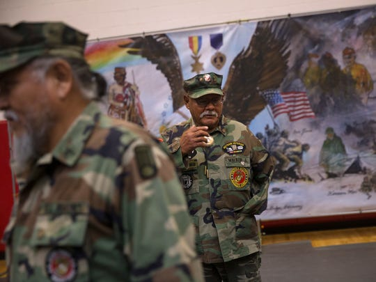 Vietnam veteran Jasper Walker talks with fellow veterans Thursday during a Vietnam veterans pinning ceremony at Navajo Technical University in Crownpoint.