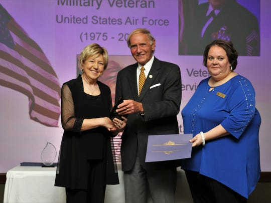 Mayor Jerry Gist (center) and JABPW President Stacy Miller (right) present Judy Bivens (left) with the 2018 Outstanding Woman Military Veteran Award on April 10 during the 9th annual Sterling Awards ceremony in the J. Walters Barnes Center at Jackson-Madison County General Hospital.