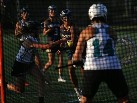 Naples' Chloe Quintero takes a shot at the goal during the regional girls lacrosse quarterfinal between Gulf Coast and Naples on Thursday, April 26, 2018.
