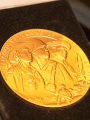 A close up view of the Congressional Gold Medal awarded