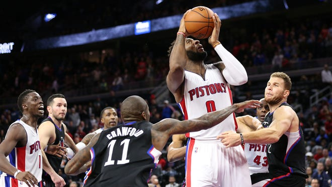 Dec 14, 2015; Auburn Hills, MI, USA; Detroit Pistons center Andre Drummond (1) attempts to score as time runs out in the overtime period as Los Angeles Clippers guard Jamal Crawford (11) and Blake Griffin (32) defend at The Palace of Auburn Hills. The Los Angeles Clippers defeated the Detroit Pistons 105-103 in overtime.