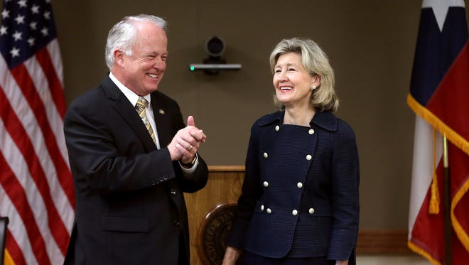 Angelo State University President Brian May and former U.S. Sen. Kay Bailey Hutchison share a laugh during a dedication for the Kay Bailey Hutchison Center for Security Studies at  ASU's Department of Security Studies and Criminal Justice in May 2016.