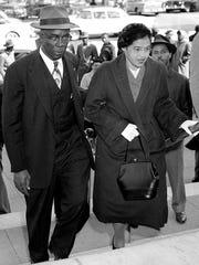 E.D.Nixon escorts Rosa Parkson March 19, 1956, for