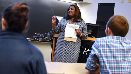 Assistant Professor of Engineering Education Monica Cox gives instructions to her class Tuesday, October 6, 2015 at Purdue in Armstrong Hall. Cox is the principal investigator of a Purdue research project looking why tenure-track women faculty in engineering persist with the barrier they face.