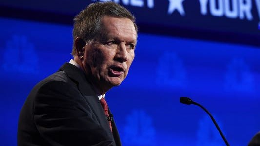 John Kasich, shown at a debate this fall in Colorado, has qualified for the Fox Business Network debate Thursday in North Charleston, South Carolina.