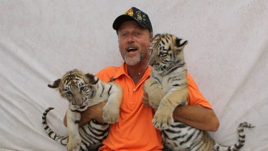 Tim Stark, owner of Wildlife in Need Inc., with his tiger cubs Ockshay and Luush.