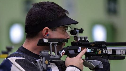 Spc. Dan Lowe takes aim during 10-meter air rifle competition Monday at the Olympic Shooting Center.