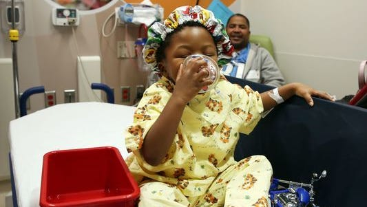 George K. Owens Jr., 3, wears his PAW Patrol surgical hat and smells his mask before his surgery. In attempt for children be more involved, the staff allows them to choose which surgical hat they would like to wear, and what scent the children would like in the anesthesia masks.