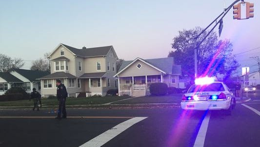 Police control the scene at the corner of Route 36 and Liberty Street in Long Branch during an armed standoff Saturday.