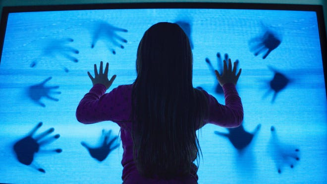 Madison Bowen (Kennedi Clements) discovers apparitions that have invaded her family's home in a scene from 'Poltergeist.'